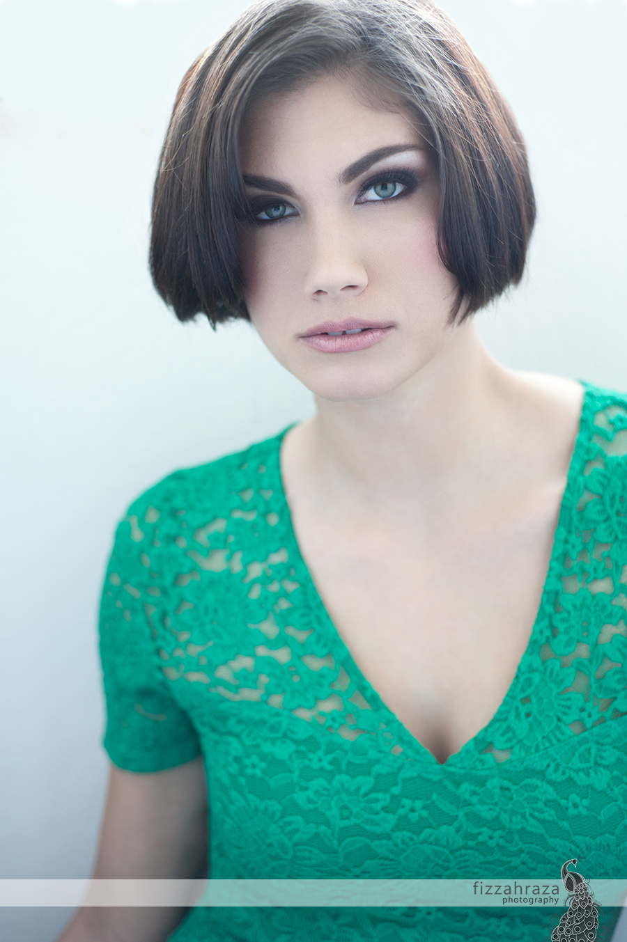 soft natural light beauty photo of woman with short hair and green eyes