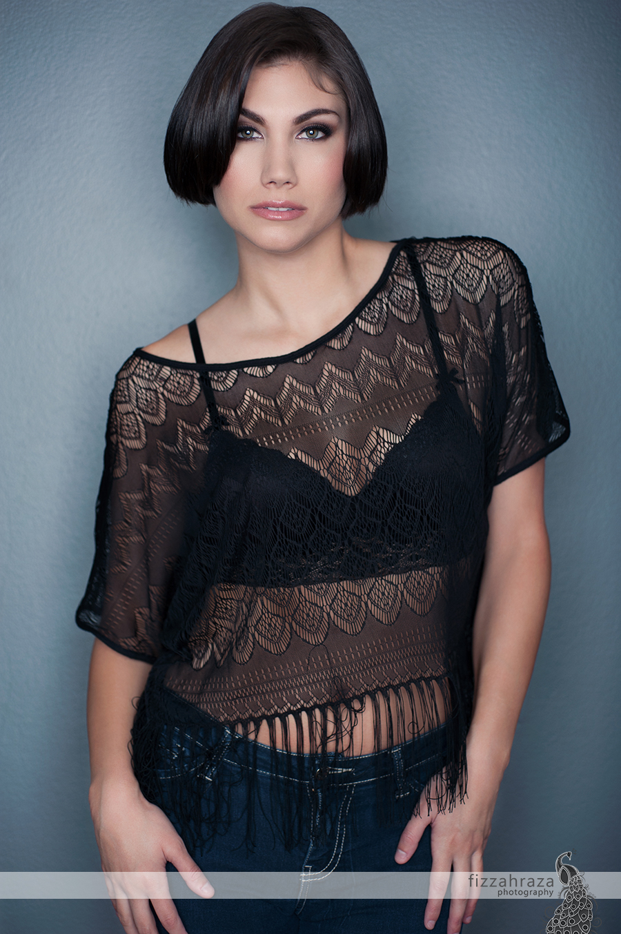 black lace top with bra and jeans glamour portrait woman short hair green eyes